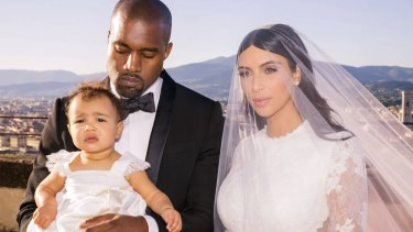 Kardashian West wore Givenchy for her wedding to Kanye West in Florence, Italy, in 2014. Pictured with their daughter, North.