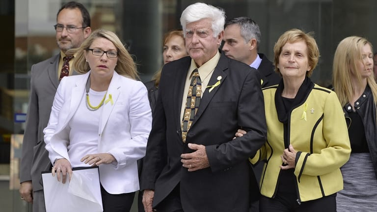 Allison Baden-Clay's parent Geoff and Priscilla Dickie leave Brisbane Supreme Court flanked by Allison's friend Kerry Anne Walker when Gerard Baden-Clay was convicted..