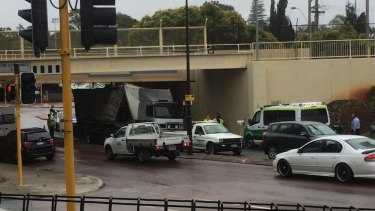 The truck gets stuck under the bridge in Bayswater.