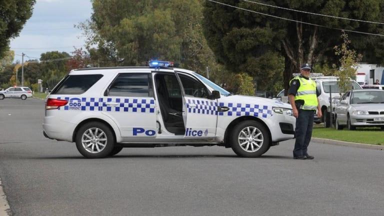 Police block the street in Wangaratta on Tuesday.