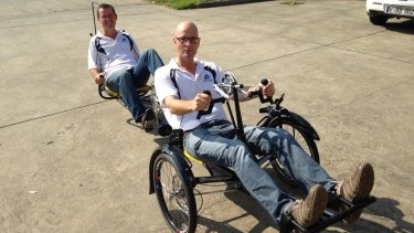 Scott Sullivan rode with his legs while and Ian Davis rode with his hands on their custom made bicycle.