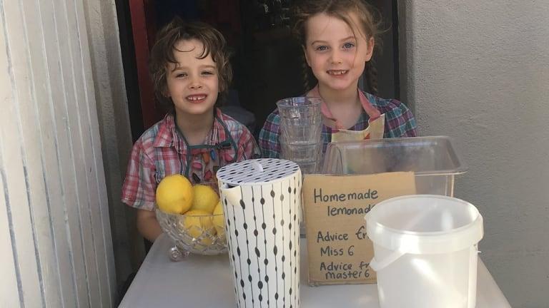 The author's children running their lemonade stand.