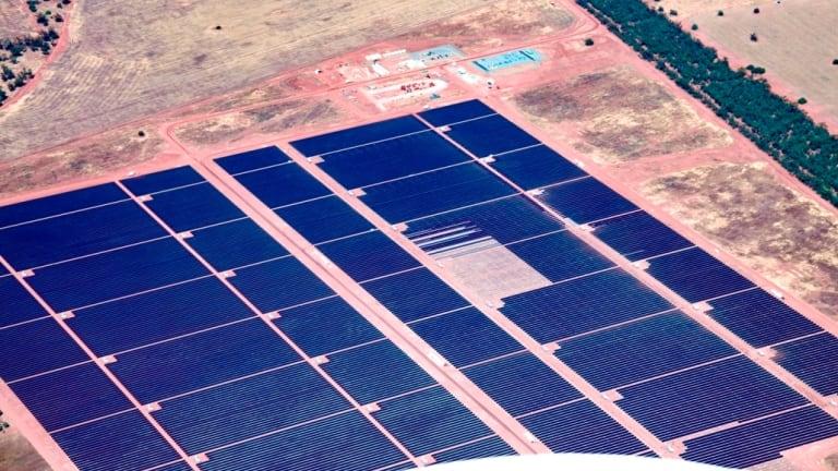 Australia's largest solar power plant gets the last of its 1,366,380 panels.