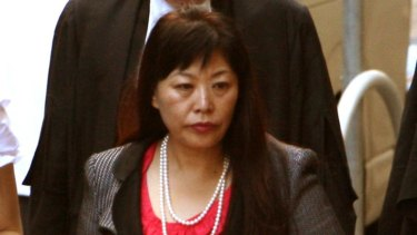 Helen Liu enters court for a defamation case in 2011.