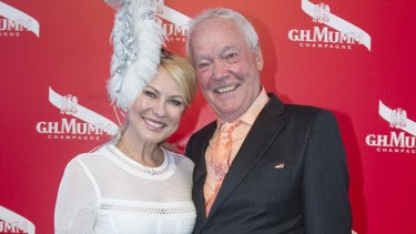 Kerri-Anne Kennerley and John Kennerley pose on Derby Day at Flemington Racecourse in 2015.