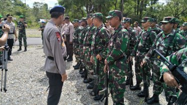 The West Papua chief of police and Papua Armed Forces commander at a joint task force ceremony last week in Timika police station, West Papua.
