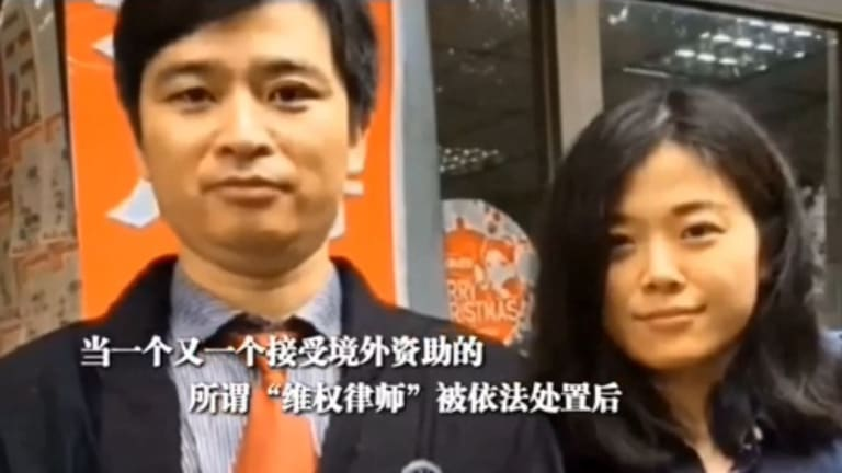 A still from the propaganda film showing legal assistant Zhao Wei, right, who is accused in the video of accepting financial assistance from overseas.