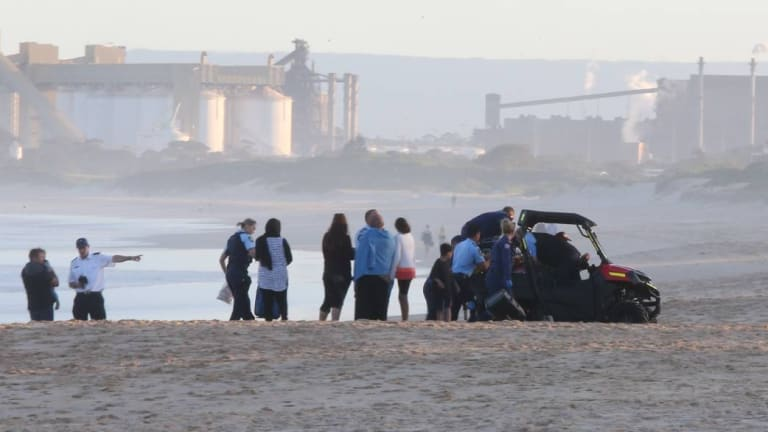 Emergency services at Wollongong City Beach, where a man drowned.