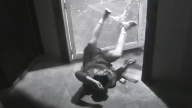 The man had almost executed his acrobatic performance when the door opened.