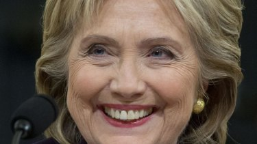 Hillary Clinton, former US secretary of state and 2016 Democratic presidential candidate, smiles during a House select committee on Benghazi hearing.