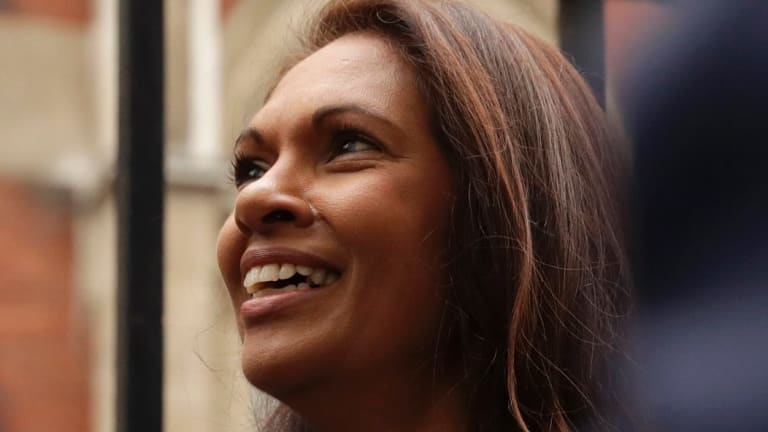 Gina Miller, a founder of investment management group SCM Private, waits before going into the High Court for the start of her landmark lawsuit.