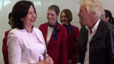 Queensland Premier Annastacia Palaszczuk - who received a kiss on her hand from the charismatic business leader - scoffed at suggestions she may have felt miffed at being called one of the girls on the stage.