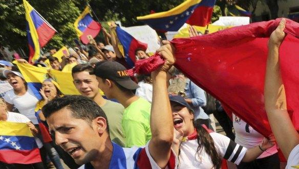 "Demonstrators chant ""Maduro out"" during an anti-government protest against Venezuelan President Nicolas Maduro in Urena, Venezuela."