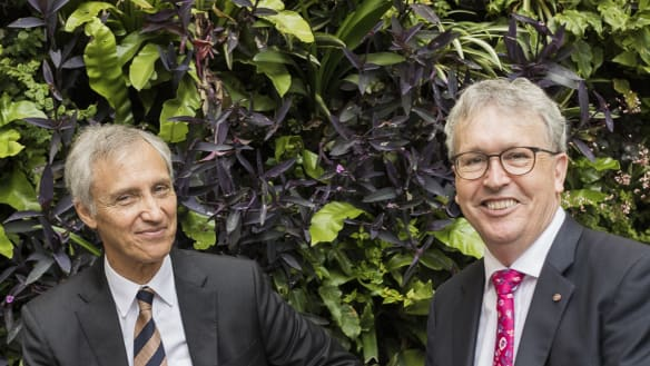 University of Wollongong Vice Chancellor Professor Paul Wellings (red tie) with Ramsay Centre CEO, Professor Simon Haines, after a deal signing on a university to the Ramsay Centre for Western Civilisation.