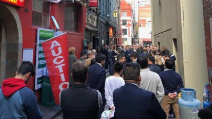 Confident buyers in Chinatown auction action