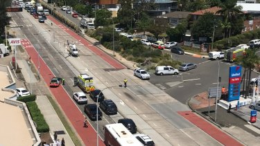 A CareFlight helicopter landed on Pittwater Road after the woman was hit by a garbage truck in Dee Why.