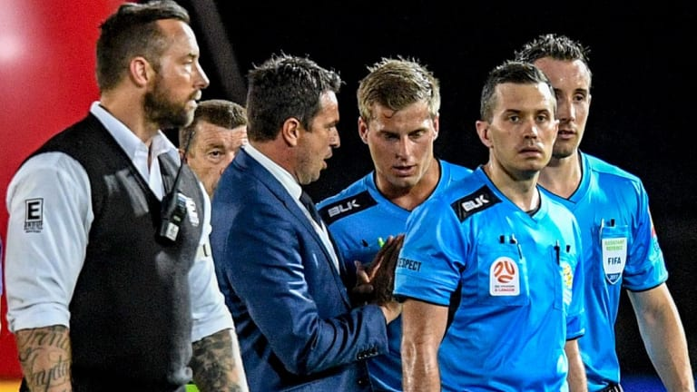 Who's in charge?: Mariners coach Paul Okon speaks with referee Alex King at the end of the controversial clash.