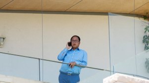 Chinese donor and gambler Huang Xiangmo pictured on the balcony of his Mosman mansion last year.