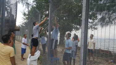 Manus Island refugees secured damaged perimeter fences at the processing centre on Monday night, fearing possible attacks.