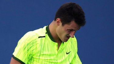 Stomach soreness has put the rest of Tomic's season in doubt.