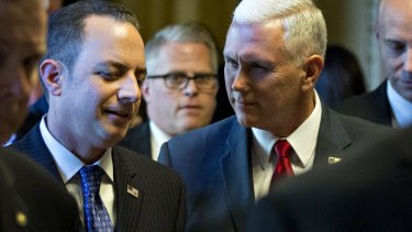 US Vice-President-elect Mike Pence talks to Reince Priebus.