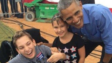 JJ Holmes with sister Grace and President Barack Obama.