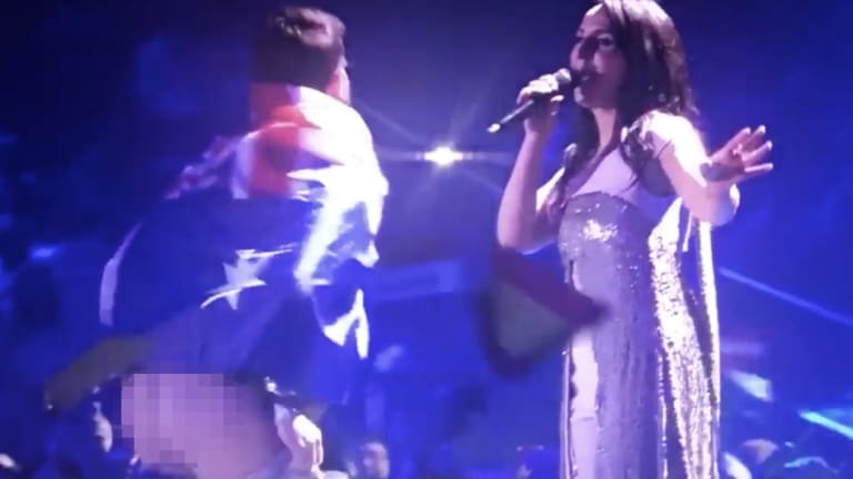 An Australian streaker has interrupted the Eurovision Song Contest.