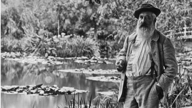 Claude Monet by his beloved lily pond in Giverny.