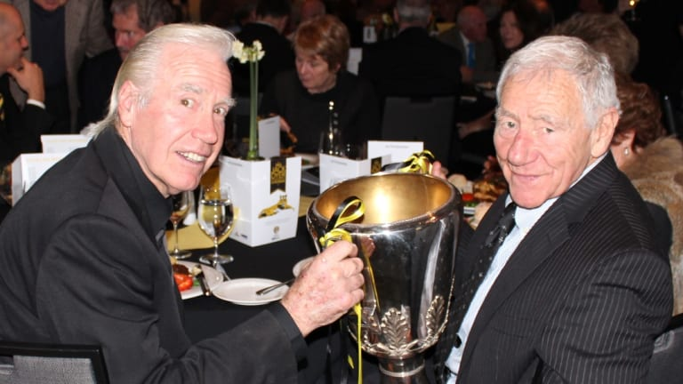 Billy Barrot with Tommy and the 1980 premiership cup in 2014.