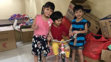 The three youngest children of Tran Thi Thanh Loan and Tran Thi Lua play in the detention centre in Kuningan, South Jakarta.