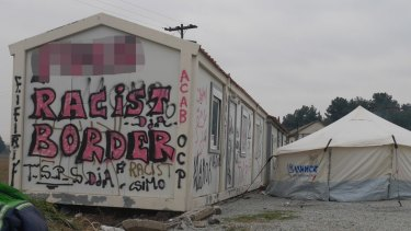 A sign near the Greek-Macedonia border where refugees who are not Syrian, Iraqis or Afghans are turned back.
