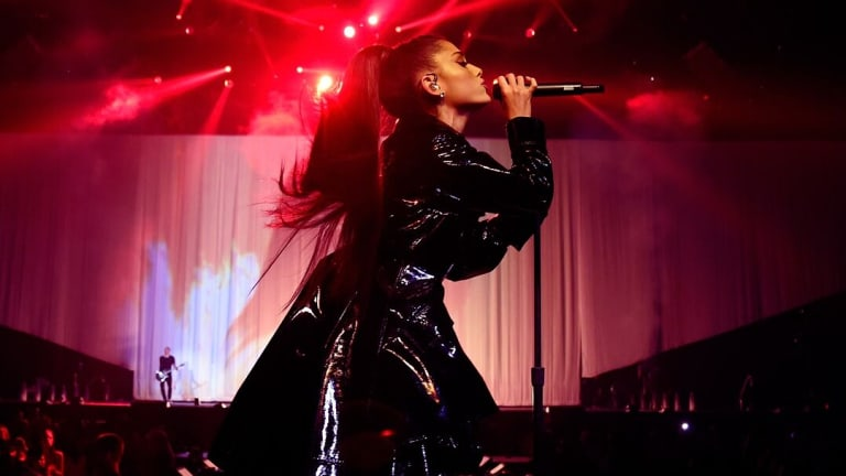 Ariana Grande singing live as part of her Dangerous Woman tour.