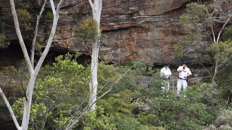 Police rescue officers near the site where a bushwalking track has collapsed.