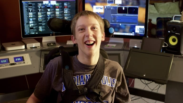 With the help of a special neck switch, Christopher Hills, 19, runs a successful video editing business.