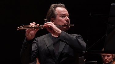 Flautist Emmanuel Pahud on stage with the Australian Chamber Orchestra.