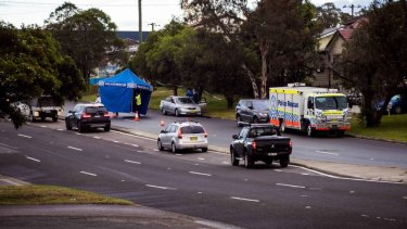 Police have set up a crime scene after finding the body of a man in the back seat of a car in Newcastle.