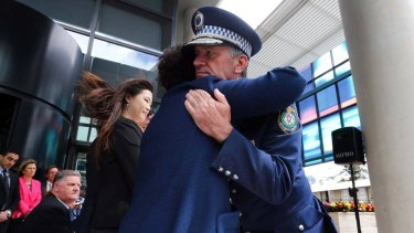 NSW Police Commissioner Andrew Scipione comforts Selina Cheng at Friday's ceremony.