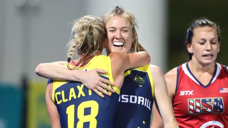 Back in the fold: Emily Hurtz celebrates with Jane Clayton during Australia's win over the United States.