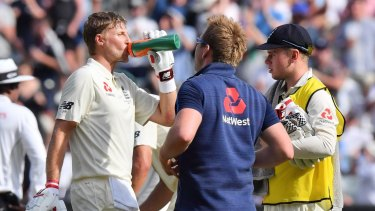 Water works: Hydration was all-important in the heat, but fluid intake might not have been enough for Joe Root.