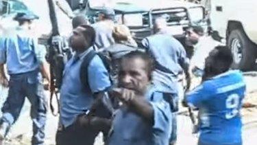 Papua New Guinea police leading Dame Carol Kidu away.