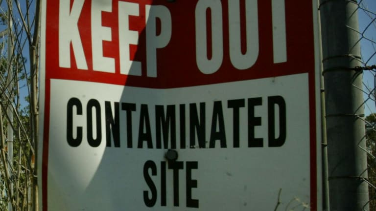 A generic 'Keep Out - contaminated site' sign.