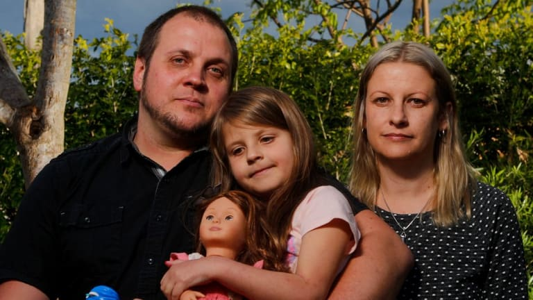 Martin Schmidt with daughter Chloe and wife Karina Schmidt. Chloe's mood and behaviour dramatically changed when she started taking Montelukast.