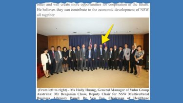 A photo from the Yuhu Group website showing former deputy premier Andrew Stoner (indicated) standing near Mr Xiangmo Huang, the Yuhu Group chairman.