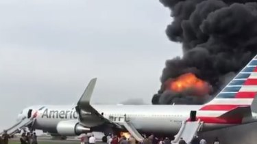 The plane burst into flames on the runway.