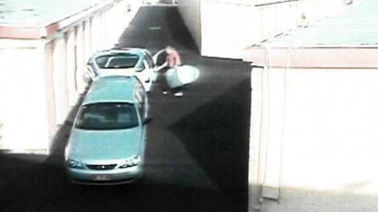 CCTV footage of the silver surfboard bag being taken out of the Ford.
