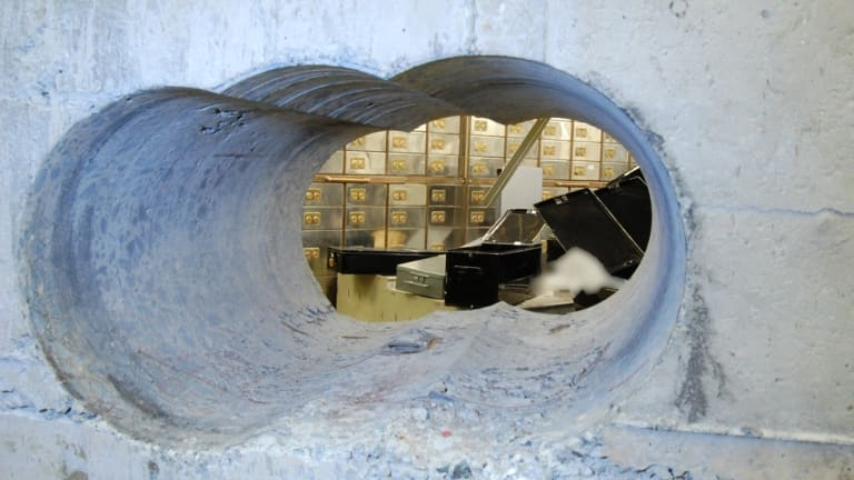 Run the jewels: The thieves used a heavy duty drill to bore holes into the vault wall.