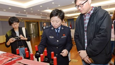 Bottles of counterfeit wine being sold on China's site, Alibaba, shown at a press conference in Shanghai on November 16, 2017. Pictures supplied by Alibaba