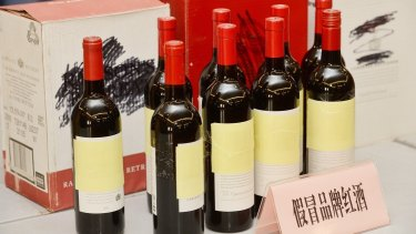Bottles of counterfeit Penfolds wine being sold through Alibaba, shown at a press conference in Shangha.