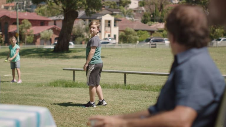 """In the TV ad, a father also yells to his son playing, """"Don't throw like a girl""""."""