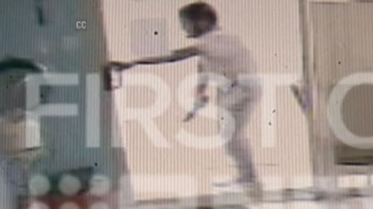 CCTV footage of alleged attacker Ihsas Khan as he tried to force his way into a hairdressing salon on Saturday.